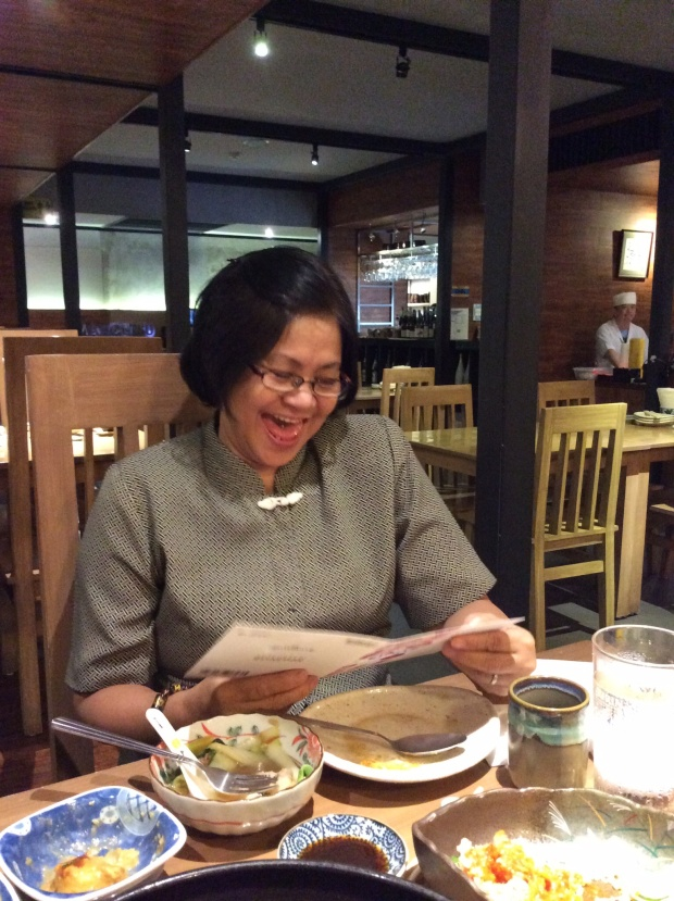 Nanay reading her card