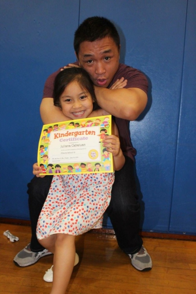 Our niece goes to AllStar too, and is currently a grey-white belt holder. For her kindergarten graduation photo with her uncle, they decided to show how to do a proper choke.